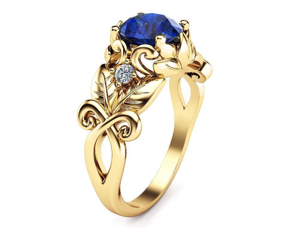 https://www.camelliarts.com/product/blue-sapphire-wedding-engagement-ring-14k-yellow-gold-sapphire-ring-unique-wedding-engagement-ring/