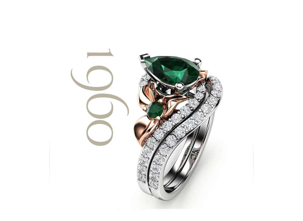 emerald engagement ring by camellia jewelry
